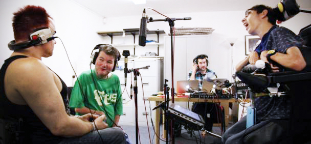 Image: 3 musicians and producer in recording studio