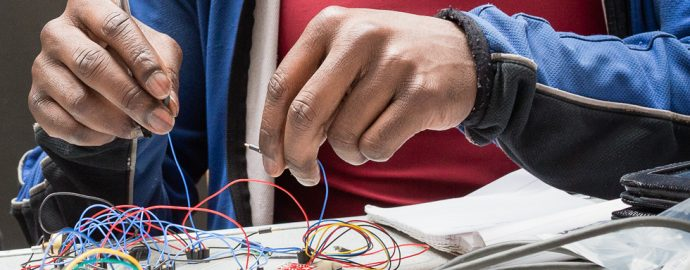 Hands holding wires delicately