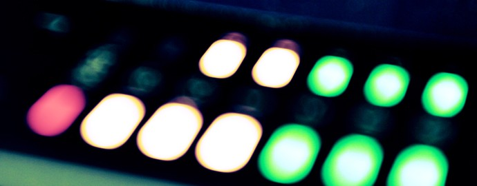 Image: green amber and red sound level lights on a mixing board