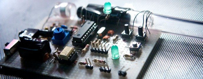 Image: close up photo of handmade electronics circuit board for an exeprimental new instrument