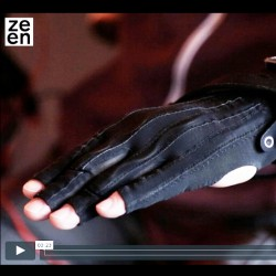 Image from Dezeen video of Kris's hand in black glove with wires