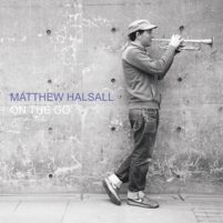 Image: black and white photo of Matthew halsall playing trumpet with text: On The Go