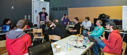 Hackathon participants working together on projects