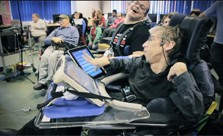 Image: still from video showing group of disabled musicians using iPads