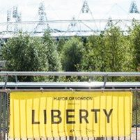 Image: Olympic staium with yellow Liberty banner