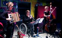 Image: 3 musicians playing accordion, clarinet & double bass