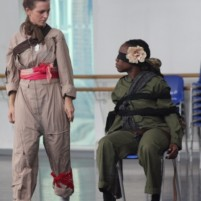 Two dancers in costume in rehearsal for performance