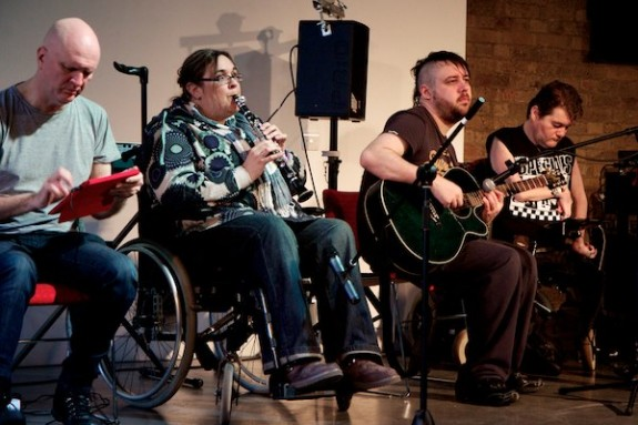Disabled musicians performing together on stage