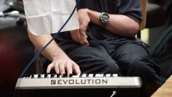 Close up of Ian playing the keyboard at the performance