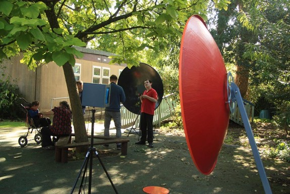 Sensory sound installation with large dishes focusing sound