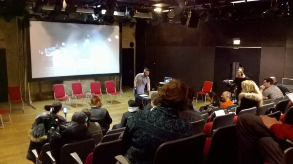 Participants watch Kris Halpin perform