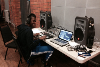 Young musician making music on laptop