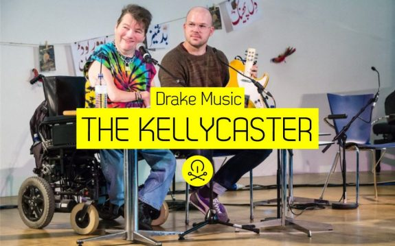 Gawain ad John Kelly present the Kellycaster - image has logo for Music Tech Fest and Kellycaster text added