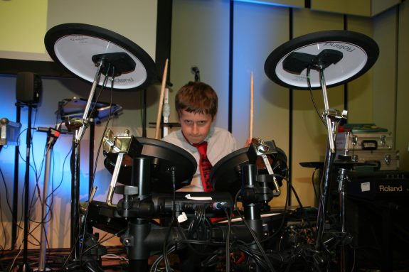 Tyler - a talented multi instrumentalist who plays in both 'Explore & 'Evolve' groups playing drums on stage