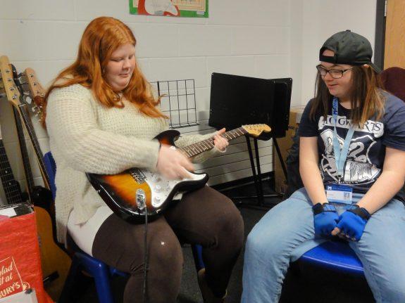 Young musician plays guitar