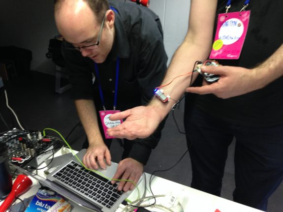A device placed on participants arm that responds to muscle movement to create sound.