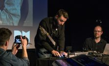 Andreas Lopez plays iPad on stage at ICA, with support from Charles Matthews