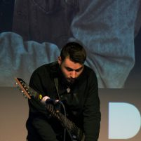 Andreas Lopez plays guitar live onstage