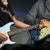 Close up of a guitar played by Royal Boil Alice