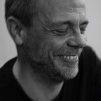 Black and white photo of Leon Clowes smiling