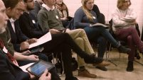 Photo: Participants playing iPads and listening to workshop presenter (out of frame)