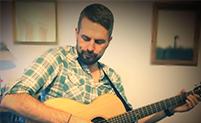 Michael plays acoustic guitar