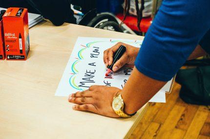 Writing a pledge sign