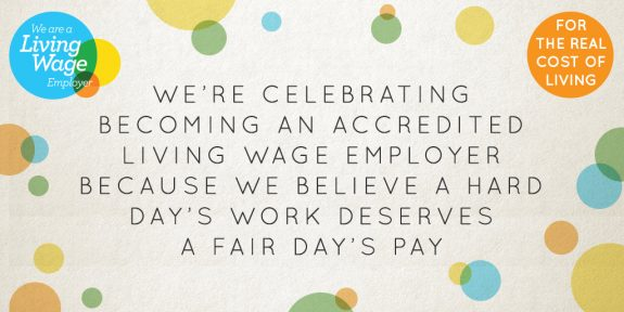 Living Wage banner reading we're celebrating becoming an accredited living wage employer because we believe a fair day's work deserves a fair fay's pay