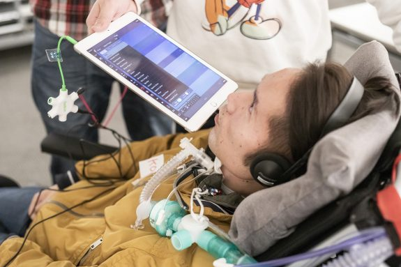 A man plays iPad using his breath