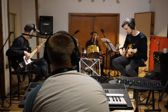 Matthew and the band record in the studio