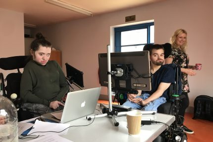 Musicians in the workroom using laptops and working hard