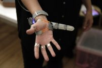 Close up on the third thumb - a plastic jointed thumb device which attaches to the hand opposite the actual thumb