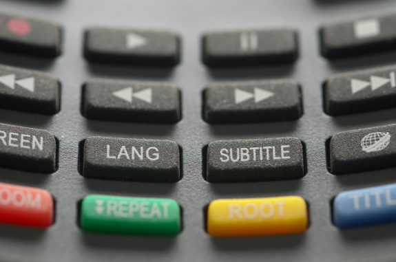 Remote control buttons, one says subtitle