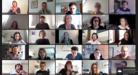 A screen capture from a Zoom call shows lots of faces in a grid format