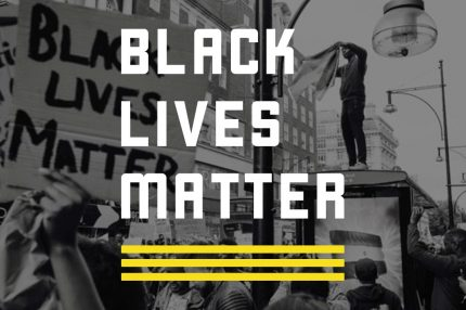 Black Lives Matter written over a black and white photo of a protest