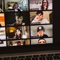 Young people's faces appear on a computer screen in a zoom call