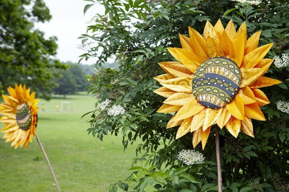 sunflowers made of African print fabric installed in a park